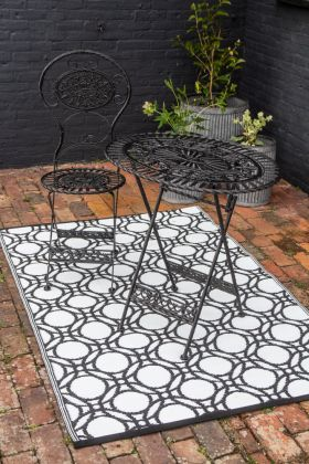 Lifestyle image of the lighter side of the Circles Reversible Outdoor Garden Rug