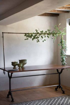 Lifestyle image of the Clamp-On Table Stand For Hanging Decorations Over Your Table