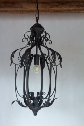 Lifestyle image of the Classic Botanical Chandelier With Leaf Decoration