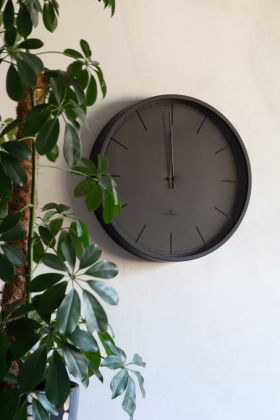 Image of the Classic Slate Grey Wall Clock hanging on the wall