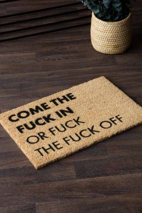 Lifestyle image of the Come The Fuck In Or Fuck The Fuck Off Doormat