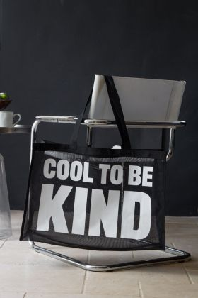 Image of the cool to be kind large shopper bag on grey chair with dark wall in background