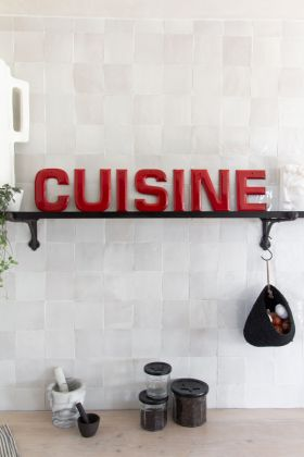 Lifestyle image of the Cuisine Wall Art In 7 Red Individual Letters