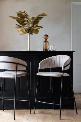 Lifestyle image of 2 Curved Back Velvet Bar Stools In Mink Grey, one facing front & one back