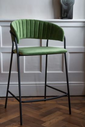 Lifestyle image of the Curved Back Velvet Bar Stool In Moss Green
