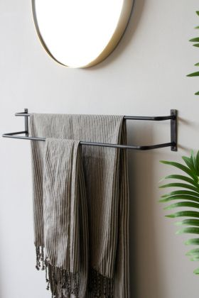 Image of the Double Rail Wall Hanging Towel Rail with towels hanging on it