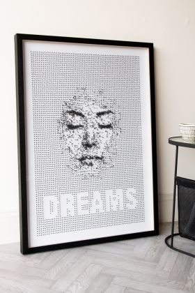 Angled lifestyle image of the Framed Dreams Typography Art Print