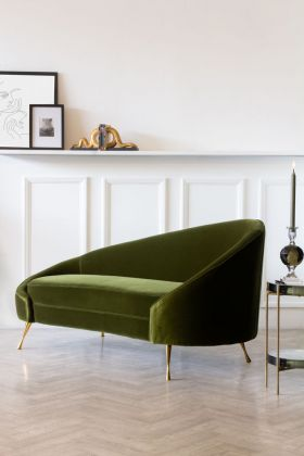 Lifestyle image of the Easy Elegance Velvet Chaise Lounge In Olive Green