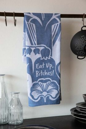 Lifestyle image of the Eat Up Bitches Floral Tea Towel