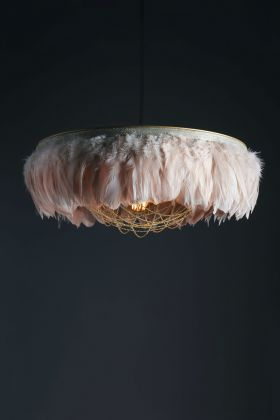 Image of the Juliette Fabulous Feather Chandelier Featuring Chains in Blush Pink on a dark background