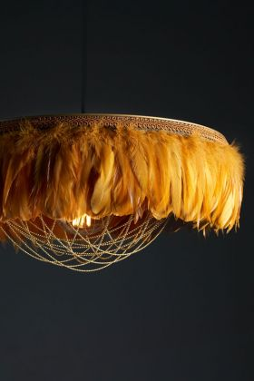 Close-up image of the Juliette Fabulous Feather Chandelier Featuring Chains in Mustard Yellow