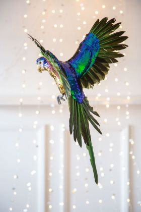Festive lifestyle image of the Small Flying Sequin Parrot Decoration