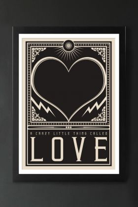 Image of the Framed Crazy Little Thing Called Love Art Print hanging on the wall