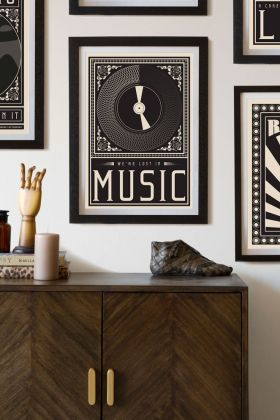Lifestyle image of the Framed Lost In The Music Art Print hanging on a wall
