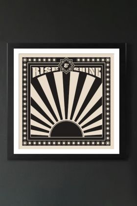 Image of the Framed Sunrise Art Print hanging on the wall