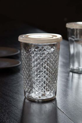 Lifestyle image of the French Tumbler Glass With Dimples & Lid