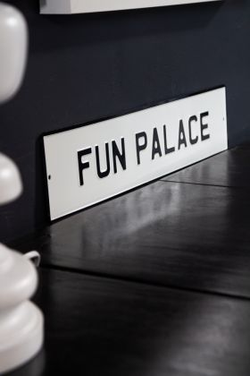Angled image of the Fun Palace Metal Sign Wall Art