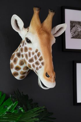 Lifestyle image of the Giraffe Head Wall Art on the wall