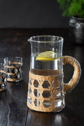 Lifestyle image of the Glass Jug With Natural Rattan Weaving