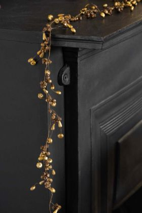 Lifestyle image of the Gold Bells Garland Decoration