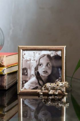 Lifestyle image of the Gold Leopard Photo Frame