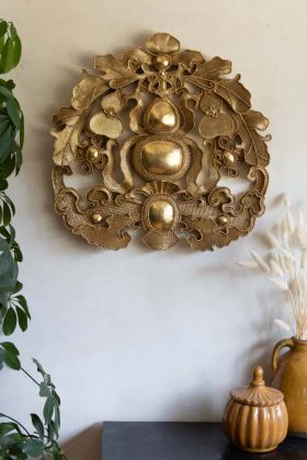 Image of the Gold Ornate Wall Hanging on the wall