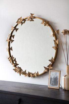 Image of the Gold Round Butterfly Mirror hanging on the wall