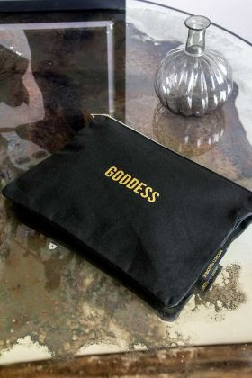 Lifestyle image of the Black Cotton Goddess Pouch Make Up Bag
