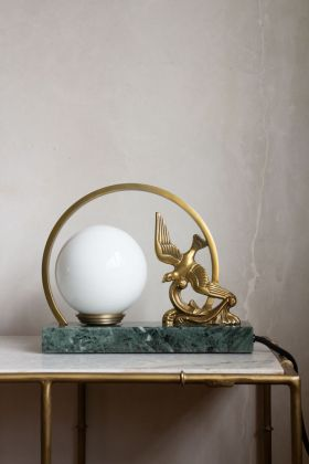 Image of the Gold Swallow & Marble Art Deco Style Wall Light on a table