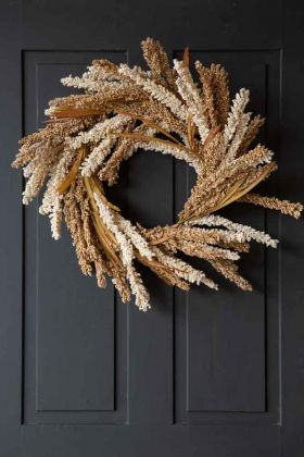Image of the Gorgeous Natural Cream Faux Floral Wreath hanging on a door