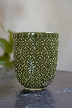 Lifestyle image of the Moss Green Fern Leaf Handleless Cup