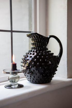 Lifestyle image of the Handmade Black Glass Bobble Jug