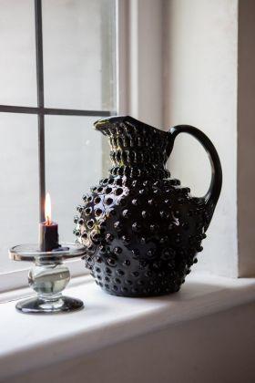 Lifestyle image of the Handmade Black Glass Bobble Jug