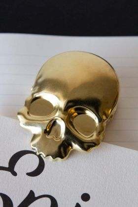 Lifestyle image of the Heavy Duty Gold Skull Clip
