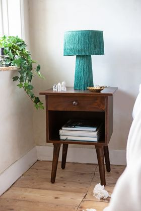 lifestyle image of the hudson bedside table with a table lamp on top