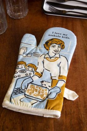Lifestyle image of the I Love My Asshole Kids Retro Oven Glove