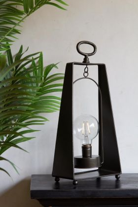 Lifestyle image of the Industrial-Style Exposed Bulb Battery Operated Table Lamp