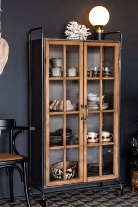 Lifestyle image of the Industrial Style Wooden Display Cabinet On Wheels with the doors closed