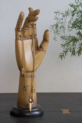 Lifestyle image of the Solid Jointed Hand Ornament