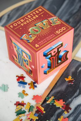 Image from above of the Knock Knock Love Four Letter Puzzle box & pieces