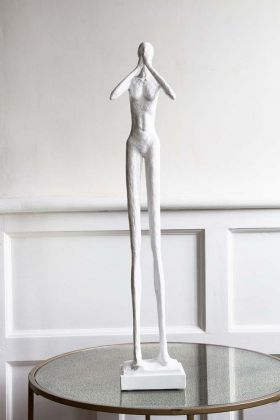 Front on lifestyle image of the Tall Silent Figure Ornament