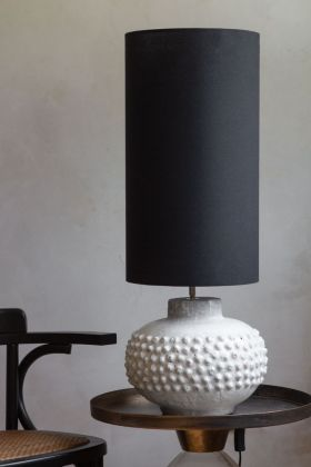 Lifestyle image of the Long Linen Table Lamp Shade In Black on a table lamp