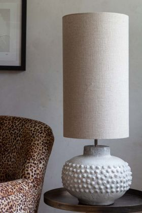 Lifestyle image of the Long Linen Table Lamp Shade In Natural Cream on a table lamp
