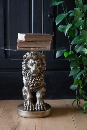Lifestyle image of the Majestic Lion Side Table With Glass Top facing front