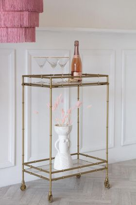 Lifestyle image of Makrana marble and brass tall rectangular drinks trolley