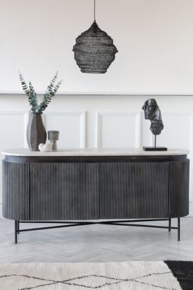 Lifestyle image of the Mango Wood & Marble Dark Oval Sideboard / TV Stand