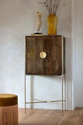 Lifestyle image of the Large Retro Mango Wood & Gold Bar Cabinet