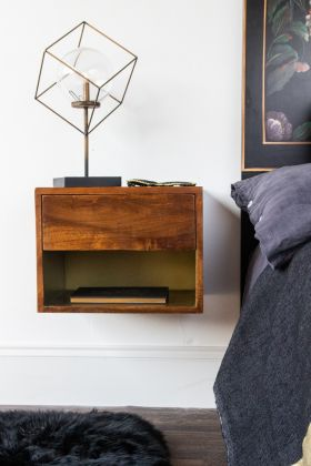 Front-on lifestyle image of the Mango Wood Wall-Hung Bedside Shelf