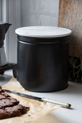 Lifestyle image of the Matt Black Steel Biscuit Tin With Marble Lid