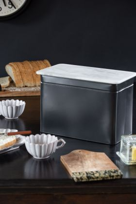 Lifestyle image of the Matt Black Steel Bread Bin With Marble Lid